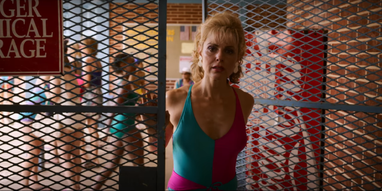 Stranger Things_A woman in a swimming suit looks opens a grid and looks in front of her