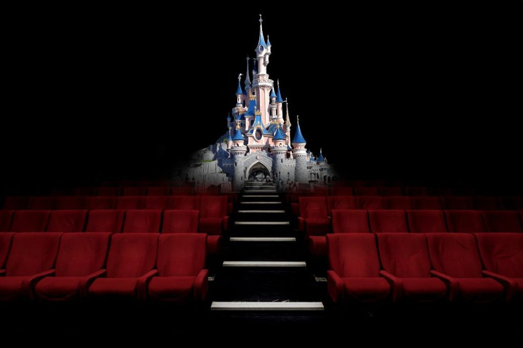 A montage of Disney's castle overimposed on a photo of an empty movie theater.